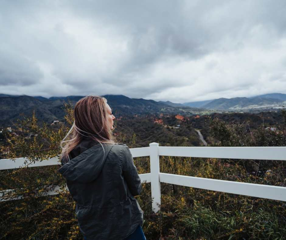 Woman looking gray skies